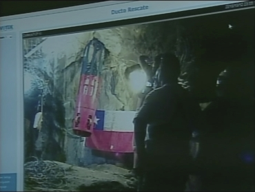 A frame grab shows Florencio Avalos, the first of 33 miners to be rescued, being hoisted out of the San Jose mine in Copiapo