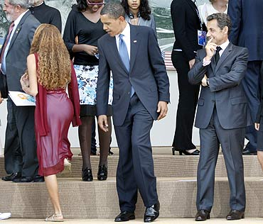 US President Barack Obama and France's President Nicolas Sarkozy with a junior G8 delegate