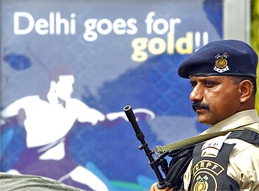 A Central Reserve Police Force personnel stands guard outside the Jawaharlal Nehru Stadium in New Delhi
