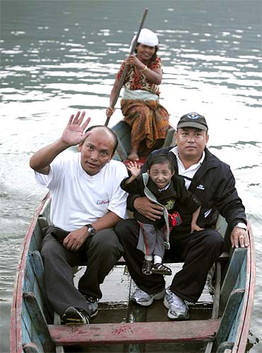 Thapa takes a boat ride at Fewa Lake with his father Rup Bahadur Thapa (Left) and his mentor and the President of Khagendra Foundation Min Bahadur Thapa