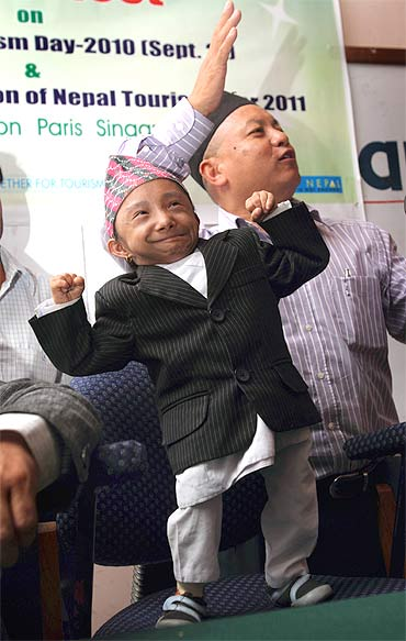 Thapa flexes his muscles during a news conference in Kathmandu