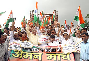 BJP supporters shout slogans during a march outside Jama Masjid in Delhi. The banner reads: Peace march against terrorism