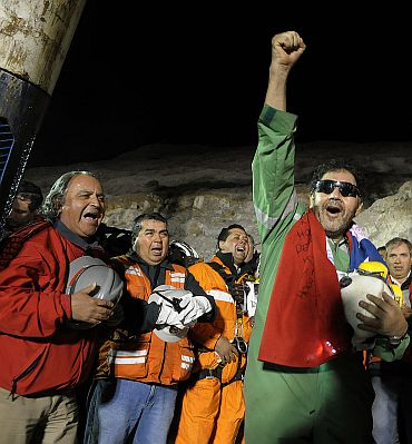 The last miner to be rescued, Luis Urzua, who is credited with organizing the miners to ration food and save themselves, gestures at the end of the rescue operation at San Jose mine in Copiapo