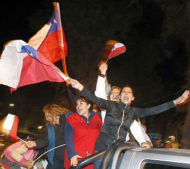 Chileans celebrate after the last miner was rescued in Copiapo
