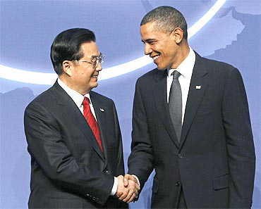 US President Barack Obama greets China's President Hu Jintao