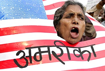 An activist from Communist Party of India (Marxist Leninist) shouts slogans against US President George W Bush during a protest against Israeli attacks on Gaza, in Allahabad