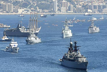 Navy ships take part with other vessels in a review