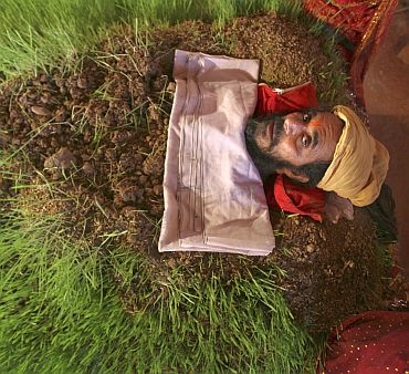 Mahant Kailash Giri, a sadhu, lies buried in soil as part of a ritual during the nine-day long Navratri festival in Jammu. The ritual was performed to appease Goddess Durga, according to Giri