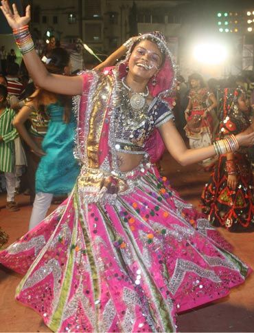 A young reveller twirls to show of her vibrant outfit at a dandiya mandal in Mumbai