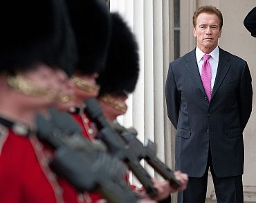 California Governor Arnold Schwarzenegger watches the changing of the guard during a visit to Wellington Barracks, in central London