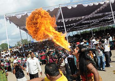 A fire eater performs at the Dusshera celebrations in Mysore