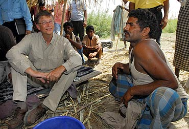 Microsoft Chairman Bill Gates interacts with a villager during a visit to Bihar in May