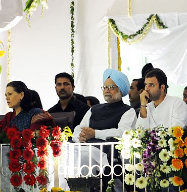 Congress president Sonia Gandhi with Prime Minister Manmohan Singh and son Rahul