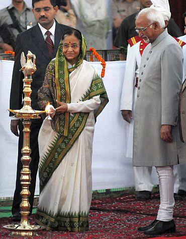 President Pratibha Devisingh Patil lighting the lamp at the Dussehra celebrations along with Vice President Hamid Ansari