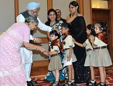 Prime Minister Dr Manmohan Singh with school children in New Delhi