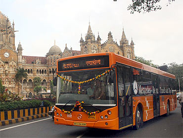 A Mercedes bus operated by BEST passes the iconic Chhatrapatti Shivaji Terminus in Mumbai