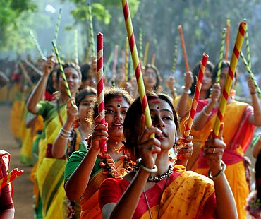 Students dance during Basanta Utsab celebrations in Shantiniketan