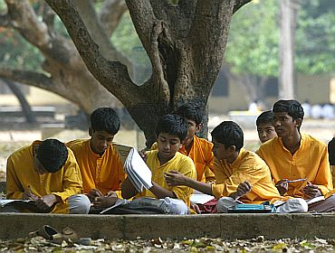 High school students sit under trees while they study in Shantiniketan, which houses the world-famous Visva Bharati university