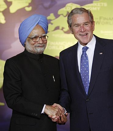 US President George Bush greets India's Prime Minister Manmohan Singh in Washington