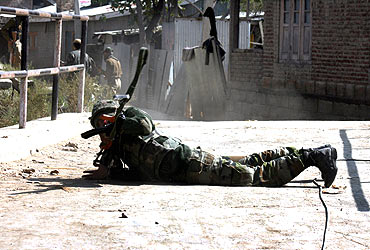 A soldier fires during the gunbattle