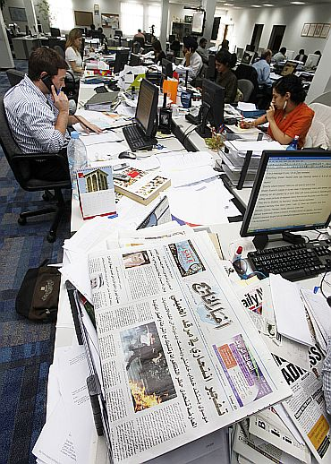 Journalists work at the Gulf Daily News in Manama which was suspended after it published a column criticising Iranian elections