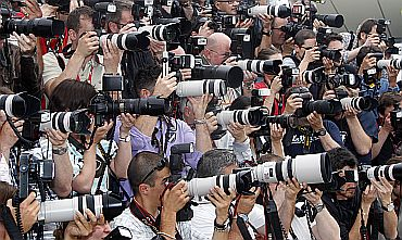 Photographers shoot with their cameras during a photocall at the Cannes Film Festival