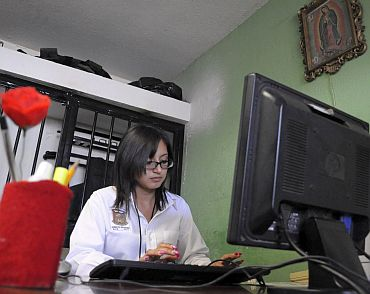 Marisol Valles Garcia sits at her desk at the police station in Praxedis G Guerrero