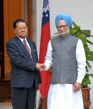 File photo shows Prime Minister Manmohan Singh with visiting Myanmar military ruler General Than Shwe