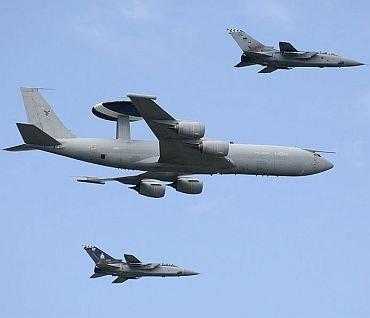 An RAF Boeing E-3D Sentry AEW1. The file photo shows E-3 accompanied by two Panavia Tornado F3s