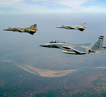 File photo shows two MIG-27 Floggers flying alongside an American F-15 Eagle