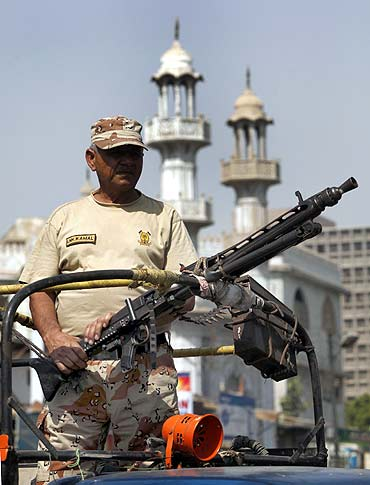 A Pakistani Ranger keeps guard in the streets of Karach