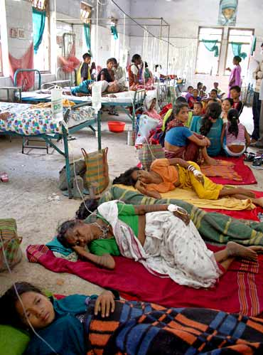 Patients, affected with malaria, crowd in a hospital ward in Naxalbari, West Bengal