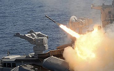 A surface-to-air missile is fired from an Indian naval warship during an exercise in the waters of Bay of Bengal