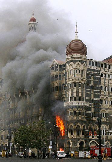 Taj Mahal hotel is seen engulfed in smoke during gun battle in Mumbai during 26/11 terror attacks