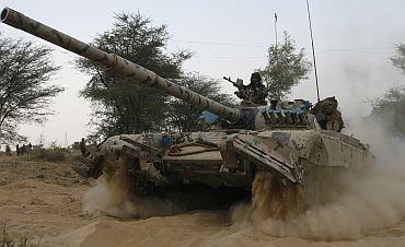 An Indian army tank moves during an army exercise at Pallu, Rajasthan
