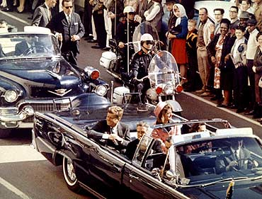 President John F Kennedy, Jacqueline Kennedy  and Texas governor John Connally ride through Dallas moments before Kennedy was assassinated, November 22, 1963