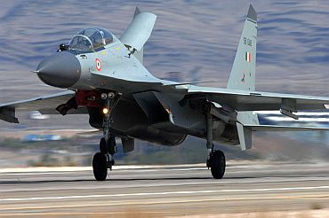 A Sukhoi jet lands at an airbase