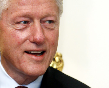 Former US President Bill Clinton attends a meeting with Egypt's President Hosni Mubarak at the presidential palace in Cairo October 5, 2010
