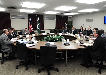 Members of the US-Pakistan Strategic Dialogue Communications Working Group interact at the US Department of State in Washington on October 20. Participants included US Department of Agriculture Deputy Under-Secretary Darcy Vetter, USAID Director Alex Their, Pakistani Minister of Agriculture Nazar Muhammad Gondal and Pakistani Secretary of Agriculture Junaid Iqbal Chowdry