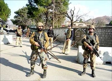 Pakistani soldiers guard a street in the Swat valley