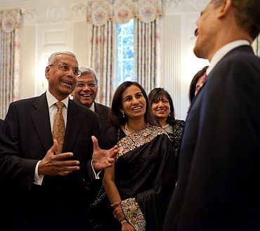 Obama interacts with American and Indian CEOs at the White House