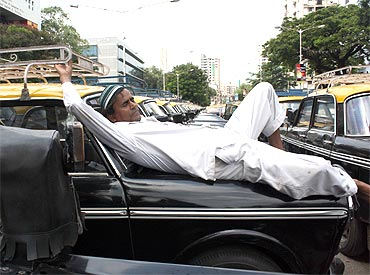 A cabbie takes a nap, not an uncommon sight in the city
