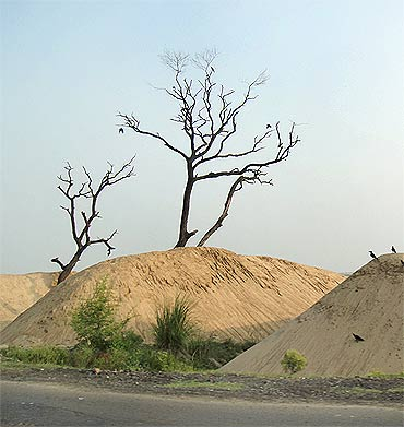 Mounds of dredged sand along the banks of the Ganga