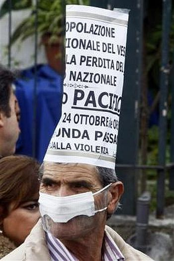 A demonstrator wears a mask during a protest against the opening of a new waste dump in Terzigno