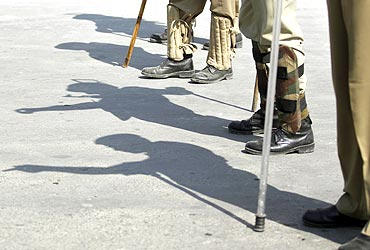 Shadows of Indian policemen are seen on a road in Srinagar