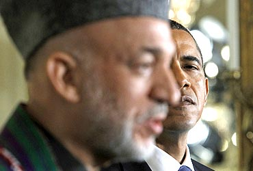 US President Barack Obama looks over at Afghanistan President Hamid Karzai during a news conference at the White House