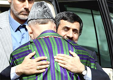 Afghan President Hamid Karzai welcomes his Iranian counterpart Mahmoud Ahmadinejad upon his arrival in Kabul