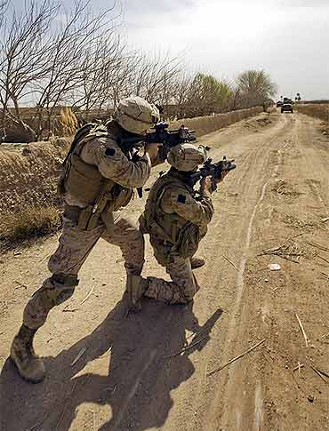 US Marines provide security during a security halt in Marjeh, Afghanistan
