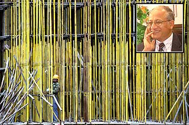 A worker installs scaffolding at a construction site in Guangdong province, China. Inset: Girija Pande