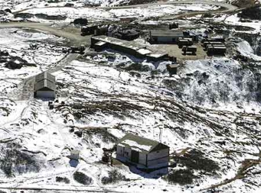 A snow-covered army camp is seen after snowfall at the India-China trade route at Nathu-La
